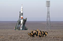 A police APC drives prior to the launch of Soyuz MS-11 space ship with U.S. astronaut Anne McClain, Russian cosmonaut ?leg Kononenko? and CSA astronaut David Saint Jacques, members of the mission to the International Space Station at the Russian leased Baikonur cosmodrome, Kazakhstan, Monday, Dec. 3, 2018