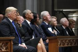 From left, President Donald Trump, first lady Melania Trump, former President Barack Obama, Michelle Obama, former President Bill Clinton, former Secretary of State Hillary Clinton, and former President Jimmy Carter listen as former President George W. Bush speaks during a State Funeral at the National Cathedral.