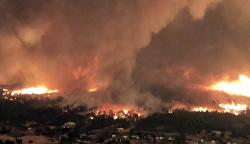 This July 26, 2018 file image taken from video released by Cal Fire shows a fire tornado over Lake Keswick Estates near Redding, Calif.