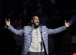 R. Kelly performs the national anthem before an NBA basketball game between the Brooklyn Nets and the Atlanta Hawks in New York.