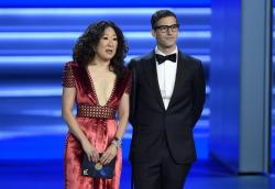 Sandra Oh, left, and Andy Samberg present an award at the 70th Primetime Emmy Awards in Los Angeles.