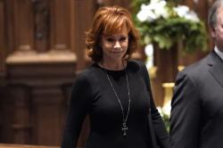 Reba McEntire arrives for a funeral service for former President George H.W. Bush at St. Martin's Episcopal Church Thursday, Dec. 6, 2018, in Houston.
