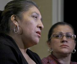 Sandra Diaz, right, listens as Victorina Morales, right, recalls her experience working at President Donald Trump's golf resort in Bedminster, N.J., during an interview, Friday Dec. 7, 2018, in New York