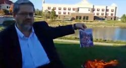 Paul Dorr seen burning LGBTQ books last October.