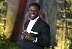 "In this Dec. 11, 2017 file photo, Kevin Hart arrives at the Los Angeles premiere of ""Jumanji: Welcome to the Jungle"" in Los Angeles"