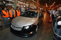 In a Dec. 7, 2009 file photo, Michigan Gov. Jennifer Granholm drives a pre-production Chevrolet Volt at the Hamtramck Assembly plant in Hamtramck, Mich.