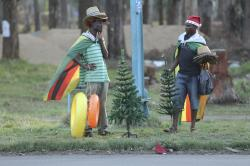 Vendors selling Christmas trees and hats on the streets of Harare take a break in this Friday, December 7 , 2018 photo