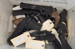 This June 2, 2018 photo provided by the Chicago Police Department shows weapons turned in by residents in a gun buy-back program co-sponsored with the New Life Covenant Church Southeast in the 6th Police District