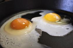 This undated photo shows the darker orange yolk of a homegrown chicken egg, left, compared with the lighter yolk of a store-bought egg in Gillette, Wyo.