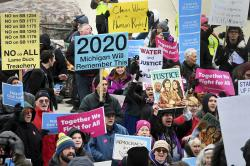 """Demonstrators gather at the steps of the Capitol before going inside to chant in the Rotunda as the Michigan Senate and House of Representatives consider bills during a """"lame duck"""" session in Lansing, Mich., Wednesday, Dec 12, 2019"""