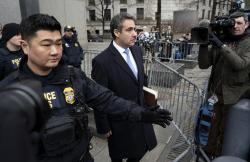 In this Dec. 12, 2018, photo, Michael Cohen, President Donald Trump's former lawyer, leaves federal court after his sentencing in New York