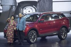 Malaysia Prime Minister Mahathir Mohamad, right, poses with his wife Siti Hasmah during the launch of Proton new SUV in Kuala Lumpur, Malaysia, Wednesday, Dec. 12, 2018