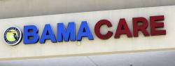 File- This May 11, 2017, file photo shows an Obamacare sign being displayed on the storefront of an insurance agency in Hialeah, Fla.