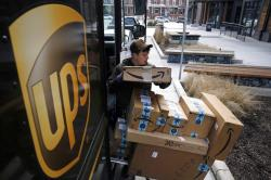 A UPS driver prepares to deliver packages in Baltimore.