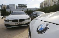 In this Aug. 14, 2018 file photo, BMW cars are parked for an emergency safety check at the playground of an elementary school near a BMW service center in Seoul, South Korea