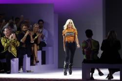 Donatella Versace comes on the catwalk at the end of Versace's women's 2019 Spring-Summer collection.