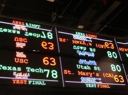 This Nov. 20, 2018 file photo shows a scrolling video board with basketball scores reflected in the ceiling of the new sports book at Resorts Casino in Atlantic City, N.J.