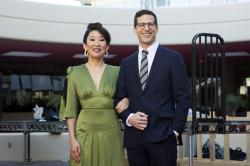 Sandra Oh, left, and Andy Samberg pose for a photo on the red carpet at the 76th Annual Golden Globe Awards Preview Day at The Beverly Hilton.