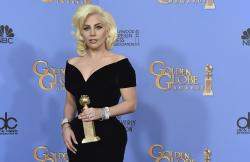 "In this Jan. 20, 2016 file photo, Lady Gaga poses in the press room with the award for best performance by an actress in a limited series or a motion picture made for TV for ""American Horror Story: Hotel"" at the 73rd annual Golden Globe Awards at the Beverly Hilton Hotel in Beverly Hills, Calif."