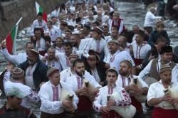 Bulgarians play bagpipes and sing in the icy waters of the Tundzha river in Kalofer, Bulgaria, Sunday, Jan. 6, 2019
