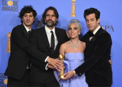 "Anthony Rossomando, from left, Andrew Wyatt, Lady Gaga and Mark Ronson pose in the press room with the award for best original song, motion picture for ""Shallow"" from the film ""A Star Is Born"" at the 76th annual Golden Globe Awards."