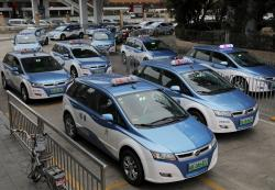 In this Monday, Jan. 7, 2019, photo, new electric-powered taxis are seen in Shenzhen city, south China's Guangdong province