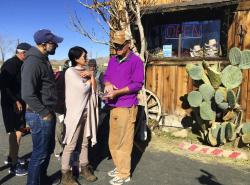 John Lauretig, executive director of Friends of Joshua Tree, talks to visitors at Coyote Corner, just outside the entrance to Joshua Tree National Park.