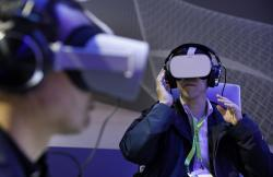 People use Oculus VR headsets at the Panasonic booth at CES International, Tuesday, Jan. 8, 2019, in Las Vegas