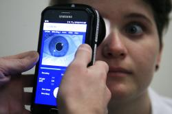 Clinical Research Assistant Kevin Jackson uses AlgometRx Platform Technology on Sarah Taylor's eyes to measure her degree of pain at the Children's National Medical Center in Washington, Monday, Dec. 10, 2018