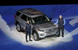 Ford Motor Co., President, Global Markets Jim Farley, left, and President and CEO Jim Hackett stand next to the redesigned 2020 Ford Explorer during its unveiling, Wednesday, Jan. 9, 2019, in Detroit
