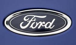 In this Tuesday, Aug. 22, 2017 file photo, a Ford emblem is seen on a car at a store in London