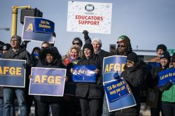 Government workers, American Federation of Government Employees union members and members of supporting local unions, pose for a group photo during the rally to highlight the effect the federal shutdown, Thursday, Jan. 10, 2019, in Minneapolis