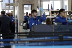In this Jan. 5, 2019, file photo Transportation Security Administration officers work at a checkpoint at O'Hare airport in Chicago
