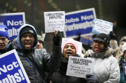 Government workers rally against the partial government shutdown at Federal Plaza, Thursday, Jan. 10, 2019, in Chicago