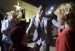 Leslie Odom Jr., the actor that plays the role of Aaron Burr greets people at the entrance plaza of the Santurce Fine Arts Center moments before the premiere of the award-winning Broadway musical, Hamilton.