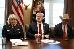 """President Donald Trump, with Carolyn """"Bunny"""" Welsh, sheriff of Chester County, Pa., left, and AJ Louderback, sheriff of Jackson County, Texas."""