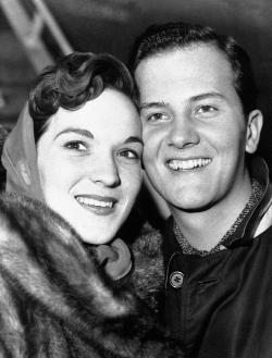 In this April 4, 1958 file photo, American singer Pat Boone and his wife Shirley are pictured at the London airport after their arrival from New York.