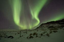 In this March 1, 2017 file photo, the Northern Lights, or aurora borealis, appear in the sky over Bifrost, Western Iceland.