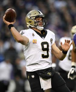 In this Oct. 21, 2018, file photo, New Orleans Saints quarterback Drew Brees (9) prepares to throw to a receiver in the second half of an NFL football game against the Baltimore Ravens, in Baltimore.