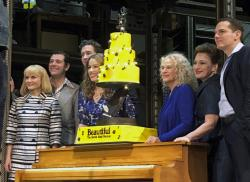 """In this Saturday, Jan. 12, 2019, photo Carole King, third from right, poses for photos with the cast of """"Beautiful: The Carole King Musical"""" at the Stephen Sondheim Theatre after a performance in New York."""