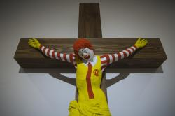 "An artwork called ""McJesus,"" which was sculpted by Finnish artist Jani Leinonen and depicts a crucified Ronald McDonald, is seen on display as part of the Haifa museum's ""Sacred Goods"" exhibit, in Haifa, Israel."