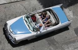 In this May 13, 2015, file photo, tourists ride a classic American convertible in Havana, Cuba