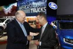 Ford Motor Co. President and CEO, Jim Hackett, left, meets with Dr. Herbert Diess, CEO of Volkswagen AG, Monday, Jan. 14, 2019, at the North American International Auto Show in Detroit