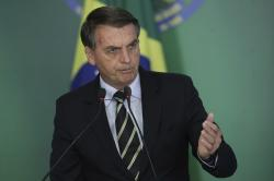 Brazil's President Jair Bolsonaro speaks during a ceremony where he signed a decree loosening restrictions on owning a firearm at Planalto presidential palace in Brasilia, Brazil, Tuesday, Jan. 15, 2019