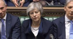 In this grab taken from video, Britain's Prime Minister Theresa May listens to Labour leader Jeremy Corbyn speaking after losing a vote on her Brexit deal, in the House of Commons, London, Tuesday Jan. 15, 2019