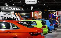 Signage for automakers Volkswagen, Acura, Chevrolet and Ford, Tuesday, Jan. 15, 2019, at the North American International Auto Show in Detroit