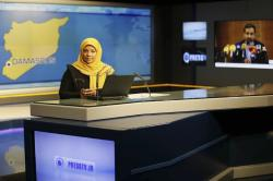 This undated photo provided by Iranian state television's English-language service, Press TV, shows American-born news anchor Marzieh Hashemi at studio in Tehran, Iran