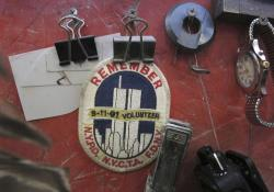 In this Tuesday, Jan. 8, 2019 photo, a badge remembering the Sept. 11, 2001, terrorists attacks hangs in the work area of a stone cutter at Rock of Ages in Barre, Vt.