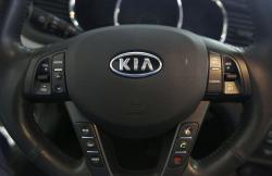 This Oct. 5, 2012, file photo, shows a Kia optima's steering wheel inside of a Kia car dealership in Elmhurst, Ill.