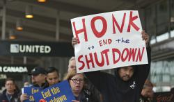 More than two dozen federal employees and supporters demonstrate at the Sacramento International Airport calling for President Donald Trump and Washington lawmakers to end then partial government shutdown, Wednesday, Jan. 16, 2019, in Sacramento, Calif.